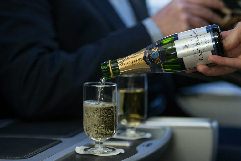 A man drinking Castelnau champagne British Airways flight