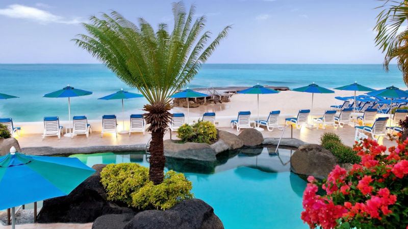 Ocean front deck chairs at the Crystal Cove by Elegant Hotels
