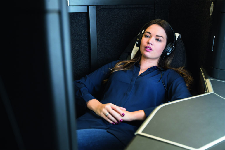 Female passenger flying in the new British Airway Club Suite
