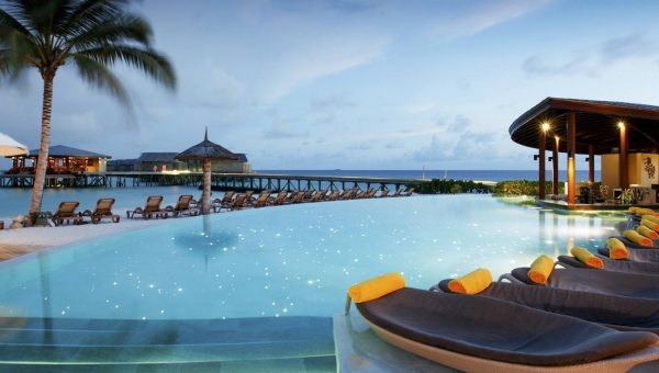 Swimming pool at the Centara Ras Fushi Resort and Spa Maldives with ocean view
