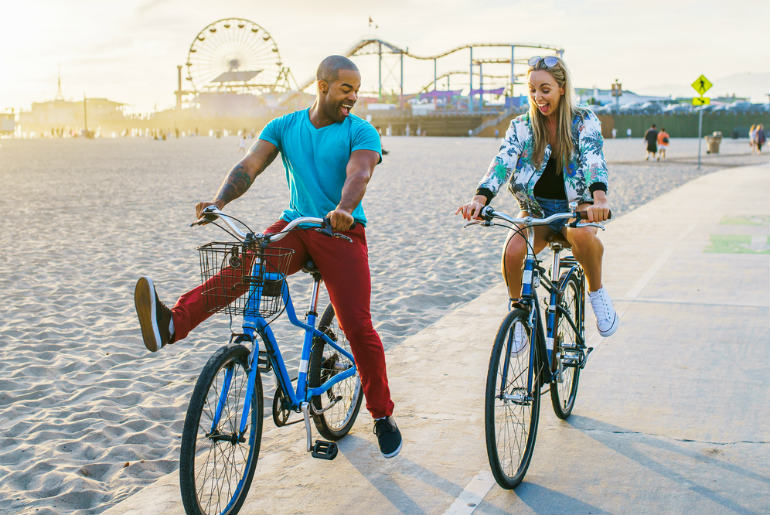Couple cycling in LA Santa Monica