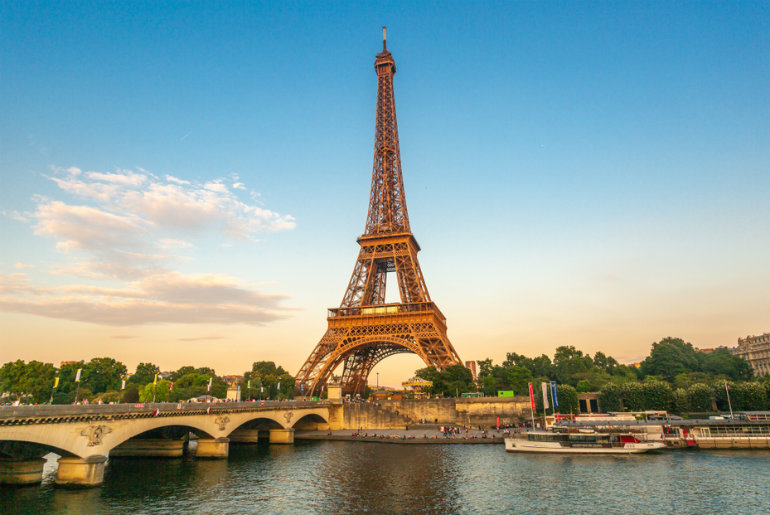The Eiffel Tower by the river Seine