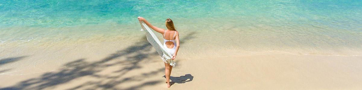Woman bathing on Barbados beach at Coral Reef Club Hotel