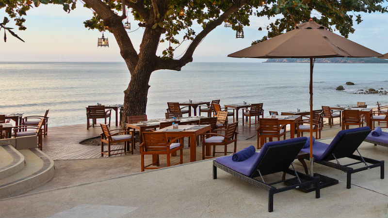 Outdoor dining at sunset at Outrigger Koh Samui