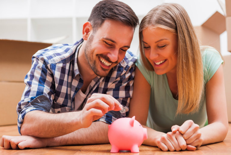 Couple with a piggy bank