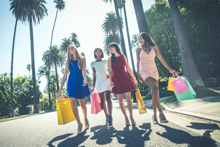Four woman shopping at the mall in Beverly Hills