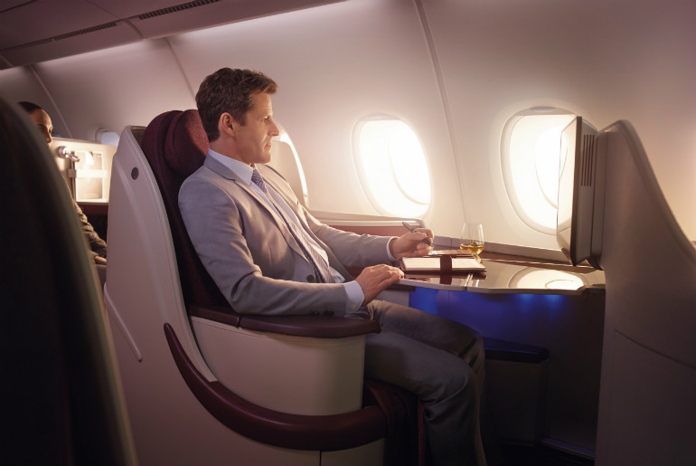 A man flying on Qatar Airways business class cabin