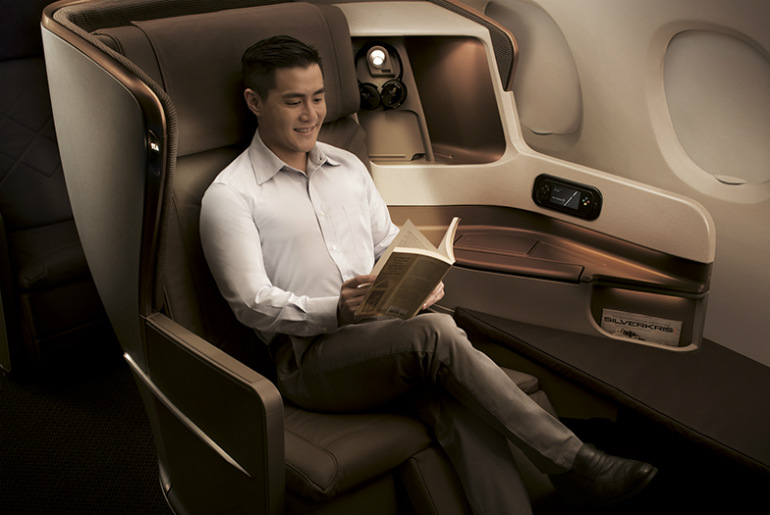 A man flying on Singapore Airlines business class cabin