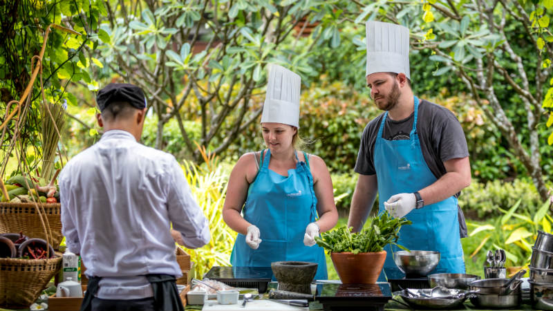 Couple doing a cooking class at Outrigger Koh Samui