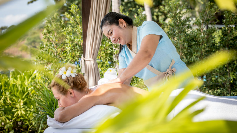 Woman getting a massage at Outrigger Koh Samui