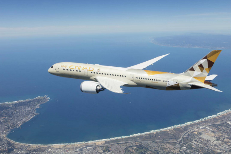 Etihad Airways Etihad Airways 787-9 Dreamliner flying in the air