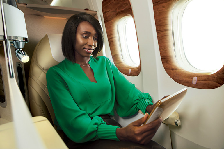 Lady sitting in a Emirates business class cabin