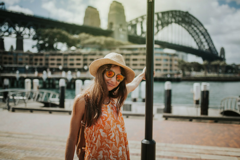 Woman posing in front of Sydney Harbour Bridge