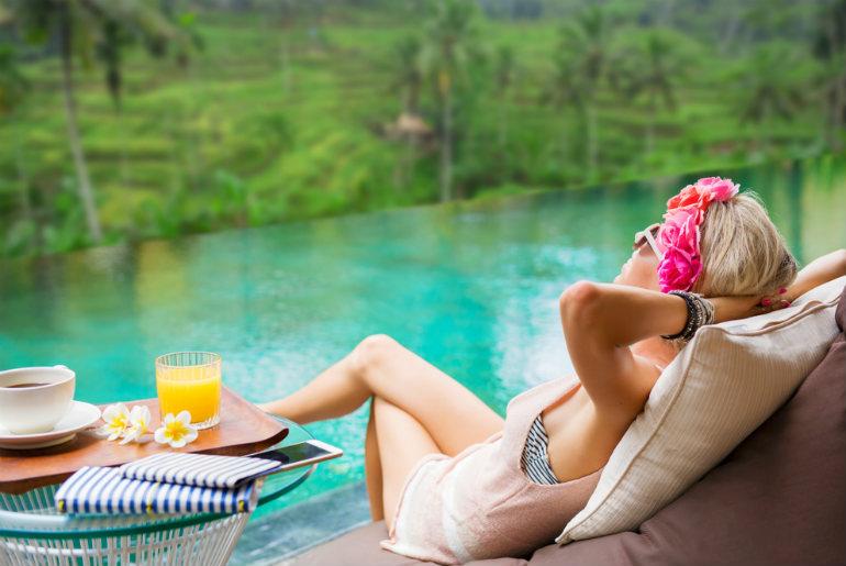 Woman relaxing in tropical villa