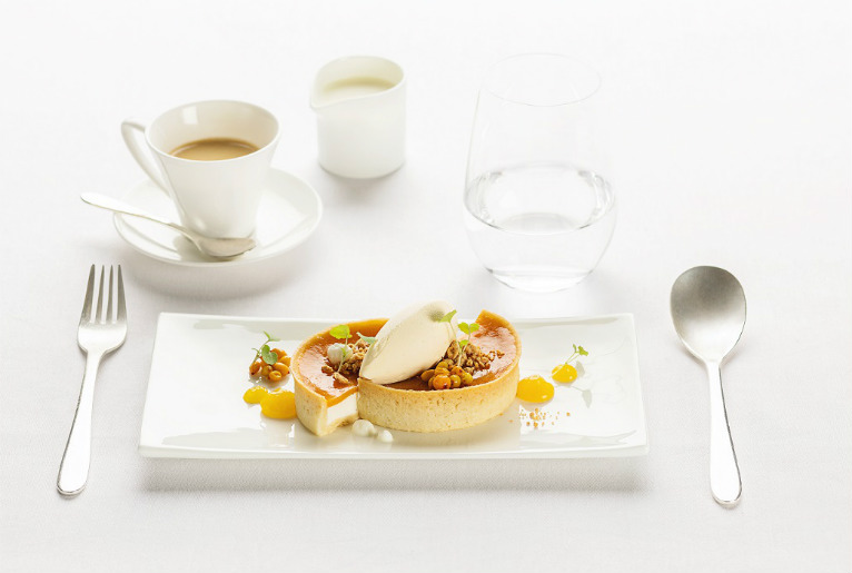 tart with sea buckthorn jelly and sour cream served on Swiss Air