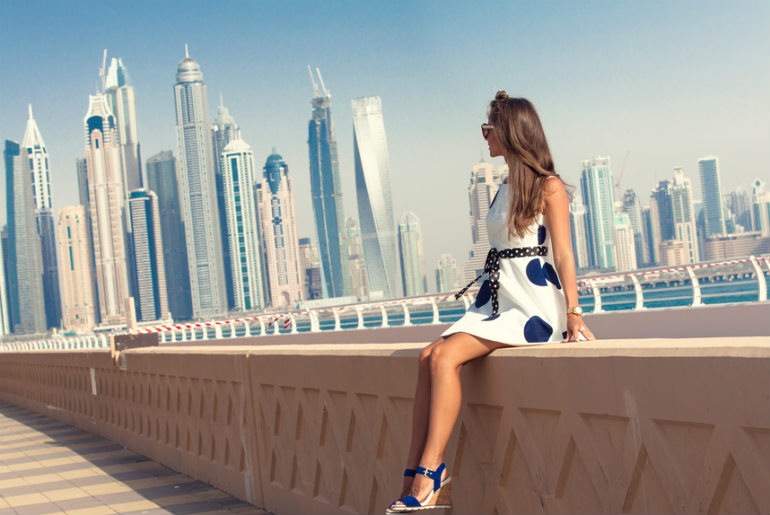 Dubai travel tourist woman on vacation in the Palm Jumeirah