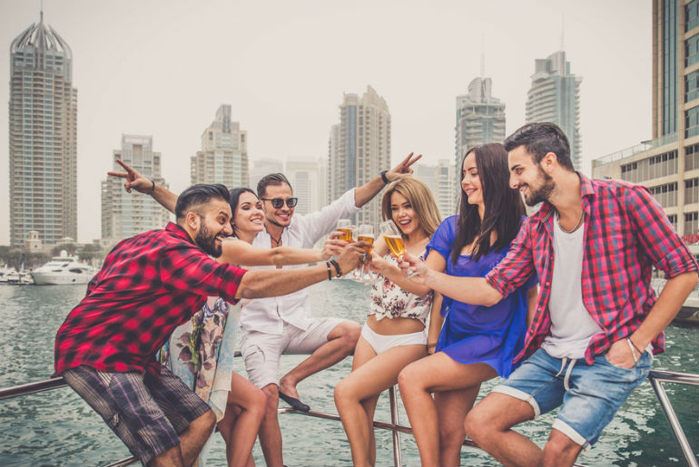 Group of friends making party on a yacht in Dubai