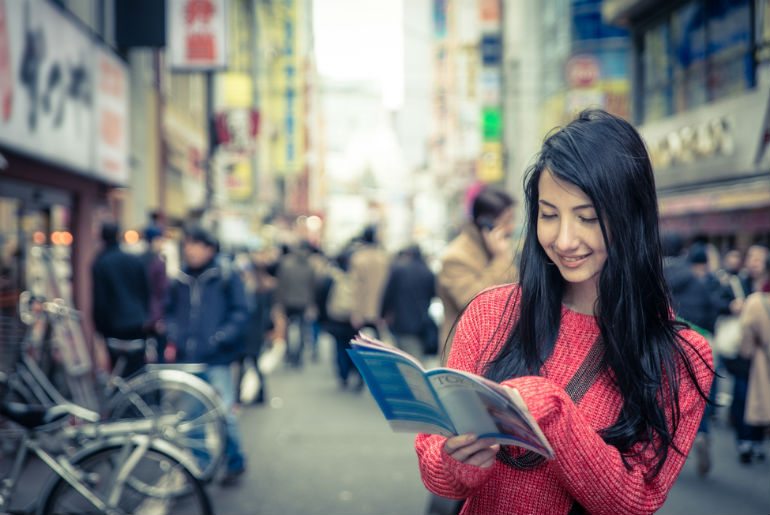 japanese girl consulting the tokyo city map