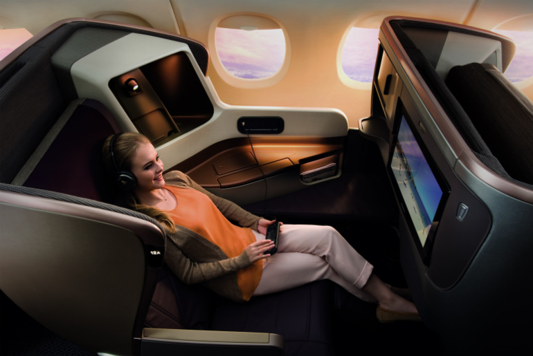 A lady sitting in Sinagpore Airlines business class cabin