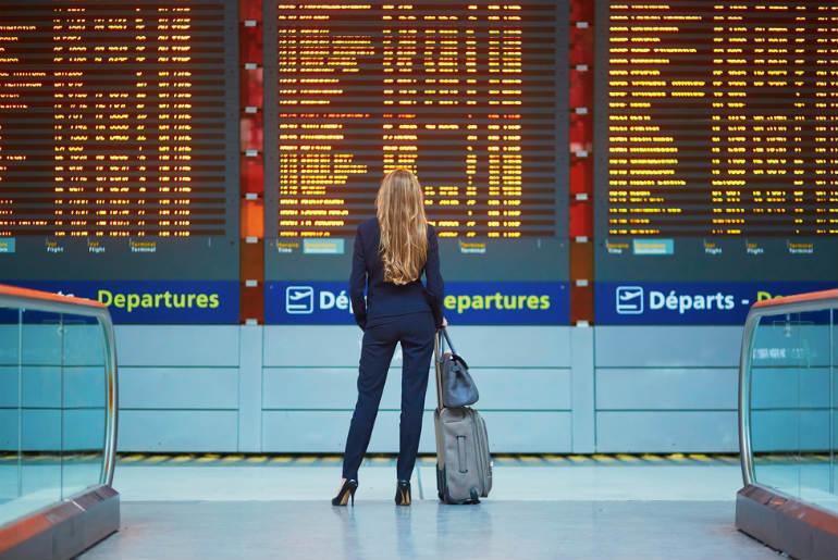 business woman at international airport terminal