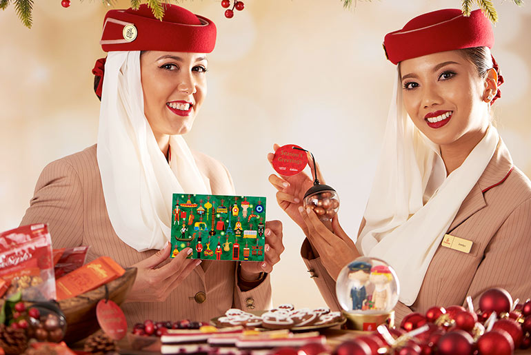 Emirates stewardess serving up Christmas menu on Emirates