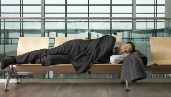 businessman asleep at the airport