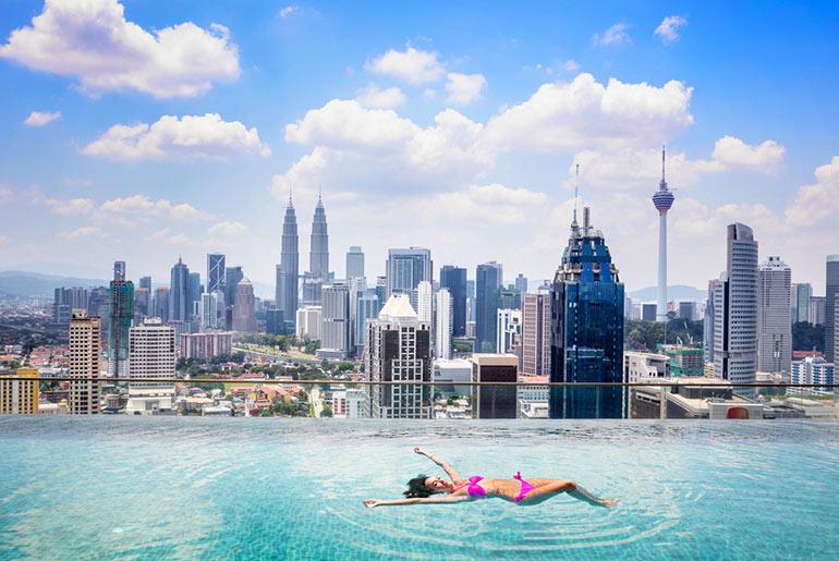 A lady in roof top pool in Kuala Lumpur Malaysia