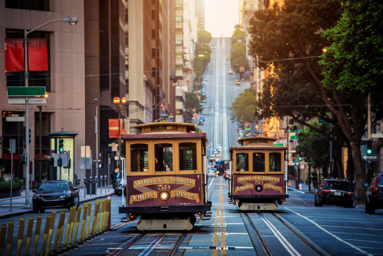 Classic view of historic traditional Cable Cars_627905945 -3 business class flights to San Francisco