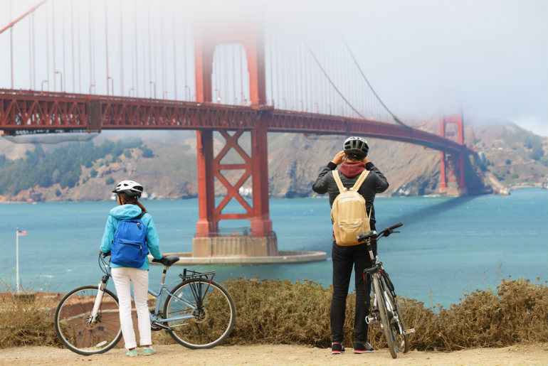 two cyclist in front of Golden gate bridge