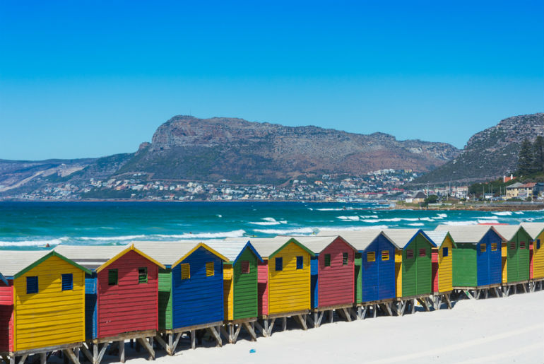 Colourful wooden beach huts on the beach at Muizenberg Cape Town