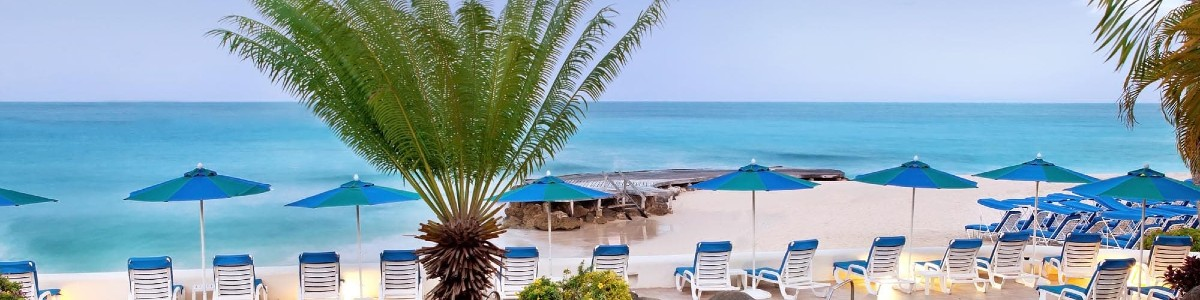 Sun Lounges on the beach at Crystal Cove Resort in Barbados